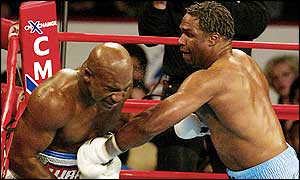 Chris Byrd (right) punishes Evander Holyfield