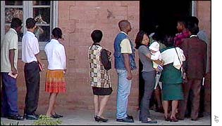 Voters queue outside a polling station in Antananarivo