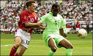 Isaac Okoronkwo holds off Michael Owen at the World Cup