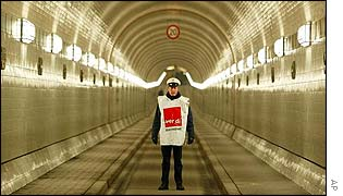 An attendant stands in an empty tube of the Old Elbtunnel in Hamburg, northern Germany