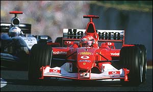Michael Schumacher's Marlboro-sponsored Ferrari leads the West-backed McLaren of David Coulthard