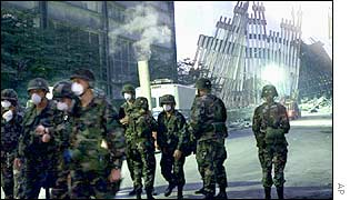 New York National Guard soldiers in front of the ruins of the World Trade Center