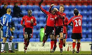Blackburn striker Andy Cole celebrates scoring