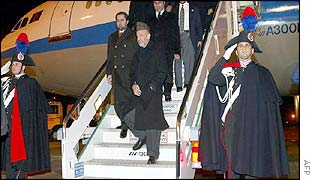 Hamid Karzai (centre) arrives in Rome for the conference