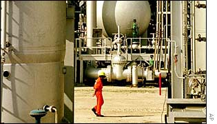A man walking through a Kuwaiti oil refinery