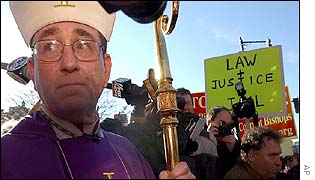 Bishop Richard Lennon with protesters in Boston
