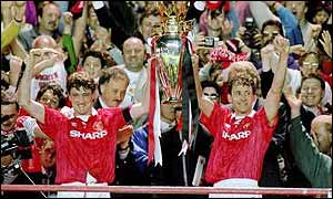 Steve Bruce and Bryan Robson lift the first ever Premier League title