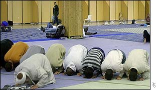 Men pray at a Muslim conference held earlier this year