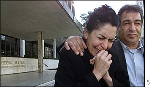 A woman sobs over the detention of her son