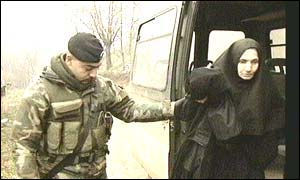 Nato soldier helps nun into car