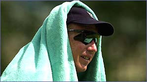 Robert Croft cools down with a towel on his head