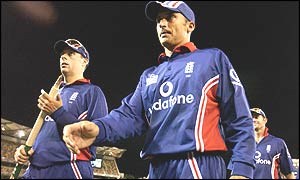 England captain Nasser Hussain (right) leads his players off the field