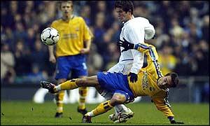 Leeds' Harry Kewell (standing) breaks away from Fabrice Fernandez of Southampton