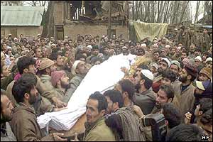 Villagers carry the body of a man killed during one of the attacks by the militants