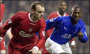 Danny Murphy and Kevin Campbell in action at Anfield