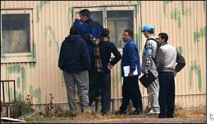UN inspectors search an aircraft hangar