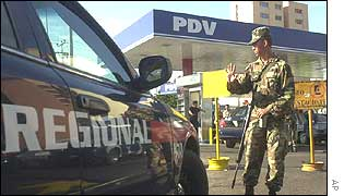 Soldier guarding a petrol station