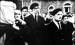 Gerry Adams forms part of an IRA funeral honour guard