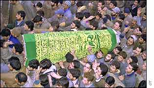 Kashmiri Muslims carry the body of slain assembly member Abdul Aziz Mir during his funeral procession