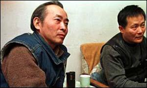 Xu Wenli (left) with fellow Democracy Wall protestor Wei Jingsheng