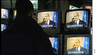 A South Korean man watches United Nations International Atomic Energy Agency director general, Mohamed ElBaradei, speak about North Korea's nuclear programme