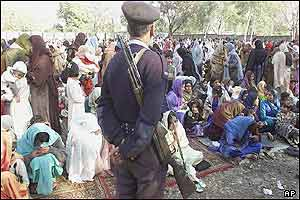 Christian community in Islamabad gather in compound of Fathima Catholic church to celebrate Christmas under tight security by police