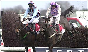 Best Mate (left) holds off Marlborough to win the King George VI chase at Kempton