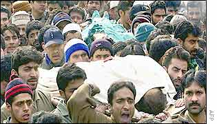 Kashmiri mourners carry the dead