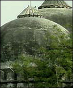 Men scrambled to the top of the dome and began to dismantle the mosque
