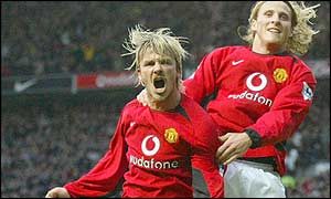 David Beckham helps Diego Forlan celebrate