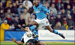 Man City's Nicolas Anelka is tackled by Fulham defender Alain Goma