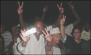 Opposition supporters flash victory signs at a party in Mombasa