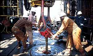 Workers operating a drill bit