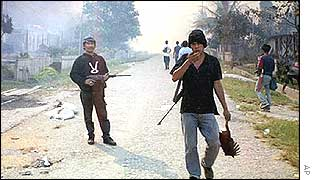 Muslim gang members carry makeshift rifles on Sulawesi island, December 2001