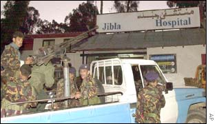 Yemeni soldiers stand guard outside the Jibla hospital