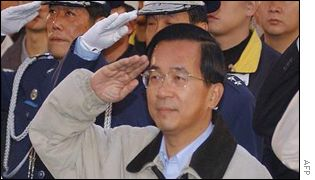 Taiwanese President Chen Shui-bian takes a New Year salute in Taipei