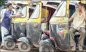 Auto-rickshaw drivers at a rank