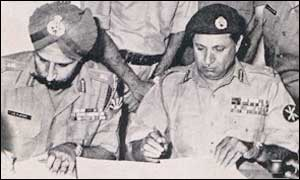 Indian General JS Arora (L) and Pakistani General AK Niazi (R) sign surrender documents in Dhaka