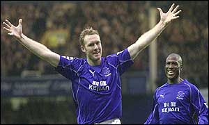 Steve Watson celebrates his early strike for Everton
