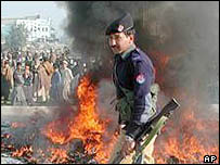 Peshawar policeman burning the material