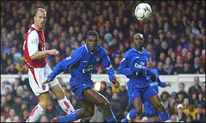 Dennis Bergkamp's shot flies in off Marcel Desailly