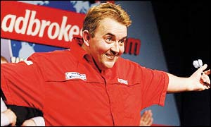 Phil Taylor celebrates after beating Wayne Mardle