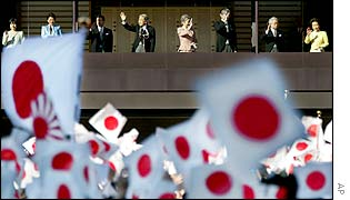 Japan's Emperor Akihito (centre left) along with other imperial family members, waves from the balcony to flag-waving well-wishers
