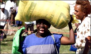 A woman in Makoni District collecting a sack of maize distributed by the World Food Programme (Picture: WFP)