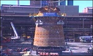 The new blast furnace is lowered into position