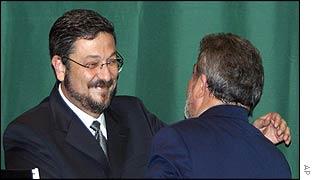 Brazilian Finance Minister Antonio Palocci hugs his President, Luiz Inacio Lula da Silva
