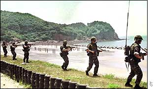 Armed South Korean Marines patrol along the seashore of Yonpyong Island