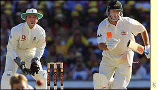 Stewart watches Waugh from behind the stumps
