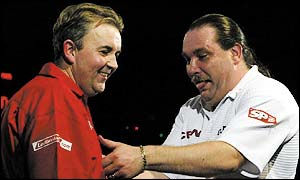 Phil Taylor (left) laughs as Dennis Smith larks about during their quarter-final