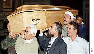 The princess' body is carried in a coffin